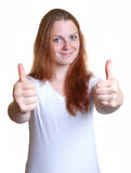 Young woman with long red hair showing thumbs Royalty Free Stock Photos
