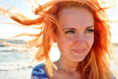 Young woman with long red hairs Stock Images