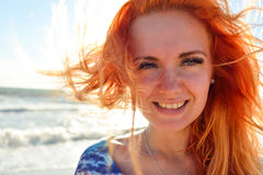 Young woman with long red hairs Royalty Free Stock Images