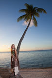 The young woman in a long sundress on a tropical beach. Polynesia. Stock Photo