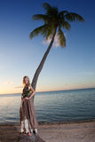 The young woman in a long sundress on a tropical beach. Polynesia. Stock Images