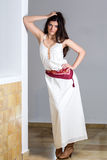 A young woman in a long white dress Royalty Free Stock Image