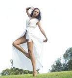 Young woman in long white dress Royalty Free Stock Images