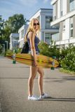 Young woman with a longboard stock photos
