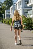 Young woman with a longboard royalty free stock photography