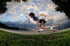 Young woman longboarding Stock Images