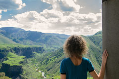 Young woman looking at amazing view. Photo of the Young woman looking at amazing view Royalty Free Stock Photography