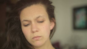 Young woman looking angrily into camera with lens distortions stock video