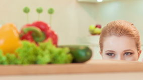 Young woman looking with appetite on vegetables stock footage