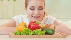 Young woman looking with appetite on vegetables stock video footage