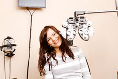 Young woman looking around optical equipment Stock Photo