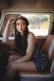 Young woman looking away while sitting in motor home Stock Photography