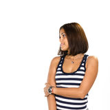 Young woman looking away at someone. Against white background Stock Photo