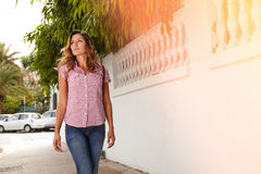 Young woman looking away while walking outdoors Royalty Free Stock Photo