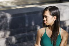 Young Woman Looking Back. Attractive Young Woman looks sad stock photos