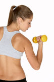 Young Woman Looking at Bicep Curl Royalty Free Stock Photos