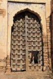Young woman looking through big gate of Taragarh Fort, Bundi,  I Stock Image
