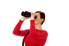 Young woman looking through a binocular Royalty Free Stock Photo