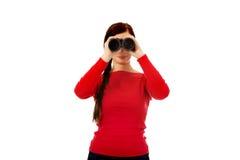 Young woman looking through a binocular Stock Image