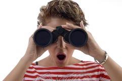 Young woman looking through binocular Royalty Free Stock Image