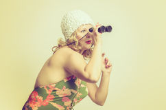 Young woman looking through Binocular Royalty Free Stock Photography