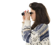 Young woman looking through binoculars Royalty Free Stock Photography