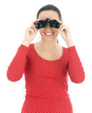 Young woman looking through binoculars Stock Photography