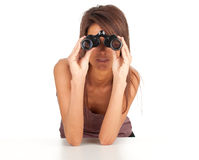 Young woman looking through binoculars Stock Photos