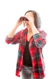 Young woman looking through binoculars Royalty Free Stock Photo