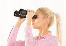 Young Woman Looking Through Binoculars Royalty Free Stock Image