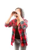 Young woman looking through binoculars and shock Stock Photo