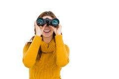 Young woman looking through binoculars Stock Photography
