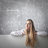 Young woman looking at a blackboard Stock Photography
