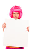Young woman looking at blank white board. Royalty Free Stock Photo