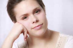 Young woman looking bored Stock Photography