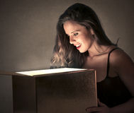 Young woman looking into a box