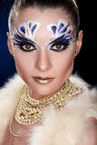 Young woman looking at the camera with fantasy make up face art studio shot. Copy space. High resolution stock photos