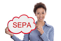 Young woman looking at camera holding a SEPA sign isolated on wh Royalty Free Stock Photo