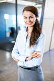 Young woman looking at camera in office Royalty Free Stock Photo