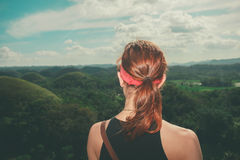 Young woman looking at the Chocolate hills, Philippines Royalty Free Stock Images