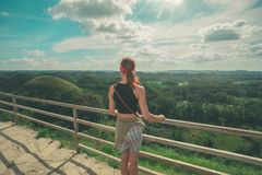 Young woman looking at the Chocolate hills, Philippines Royalty Free Stock Photo