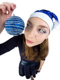 Young woman looking at the christmas ball Royalty Free Stock Image