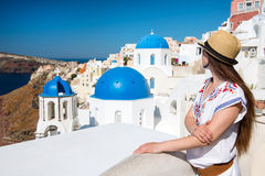 Young woman looking at churches in background, Santorini Royalty Free Stock Photo