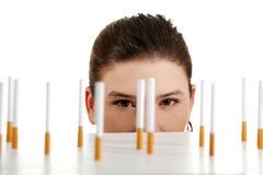 Young woman looking on cigarettes  Stock Photo
