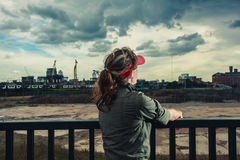 Young woman looking at city Stock Photo