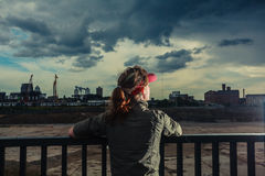 Young woman looking at city Royalty Free Stock Images