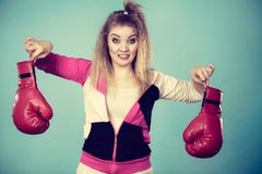 Disgusted woman holding boxing glove Royalty Free Stock Photo