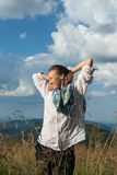 Young woman looking into the distance enjoying life Stock Photography