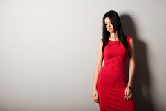 Young woman looking down. Portrait of elegant young woman looking down Royalty Free Stock Image