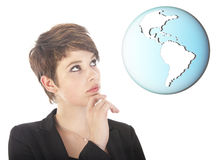Young woman looking at earth globe isolated on white background Royalty Free Stock Images